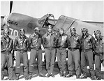 Image of Tuskegee Airmen getting ready for a flight.