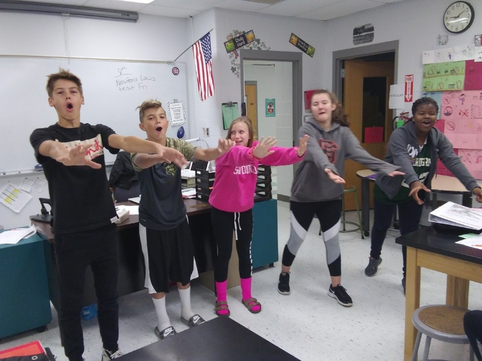 8th graders singing and dancing about forces and motion