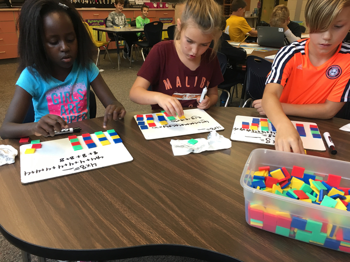 3rd graders learning multiplication by making equal groups and using repeated addition!