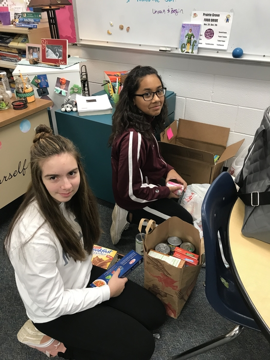 8th Grade students counting the food we collected for the food drive!