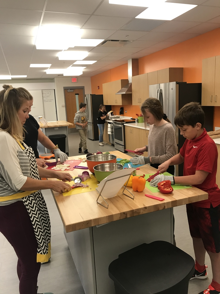 Students learning how to chop veggies