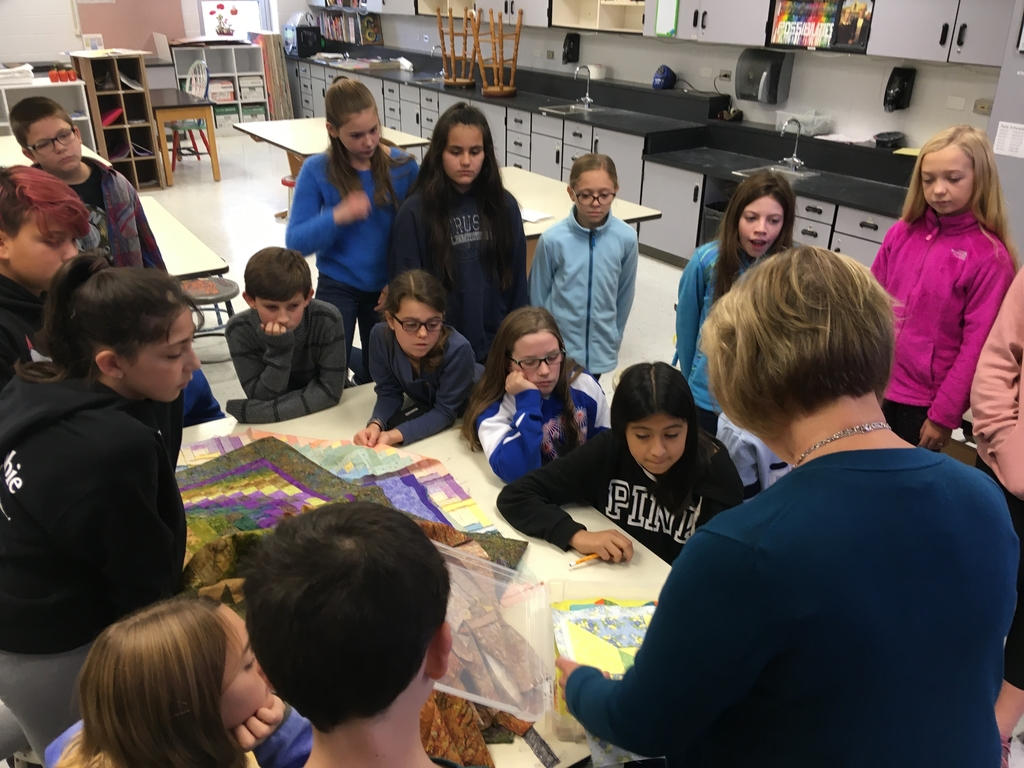 Mrs Faure presents about quilts in 6th drake art. The students Learned about code quilts and the underground railroad and are now creating their own designs and quiltsquares