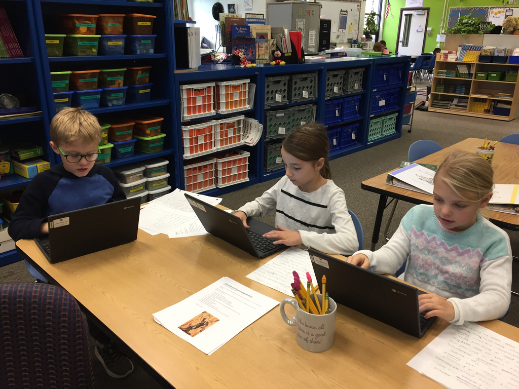 Working hard to publish their final copy of an explanatory paragraph!