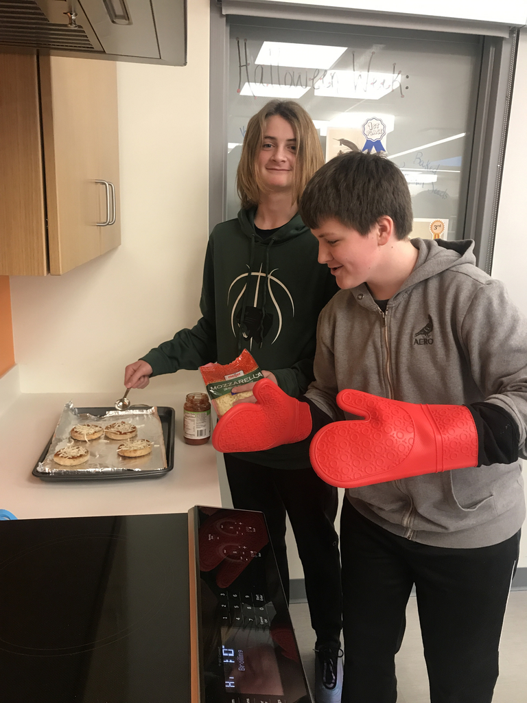 8th Grade making English Muffin pizzas!