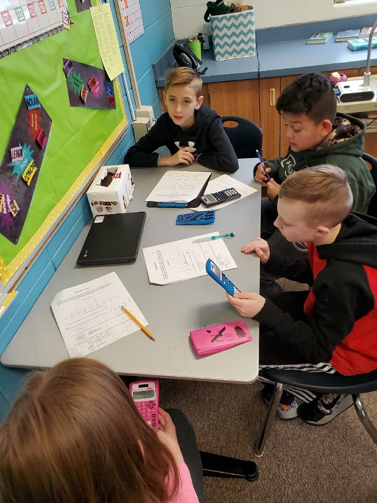 5th graders are collaborating on fraction problem solving!